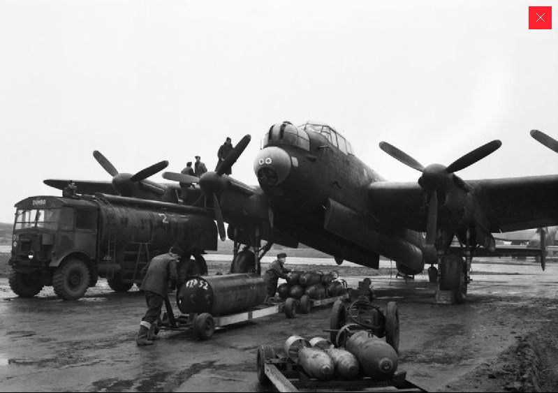 'Bombing up' a Lancaster © IWM (CH14680)